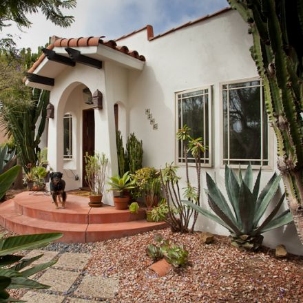 Exterior front entry design with drought tolerant succulents, cactus and stone